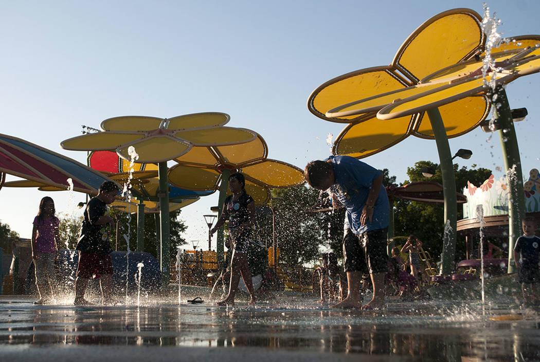 Children play in the splash pad at the Centennial Hills Park in Las Vegas in 2013. (Erik Verduzco/Las Vegas Review-Journal)