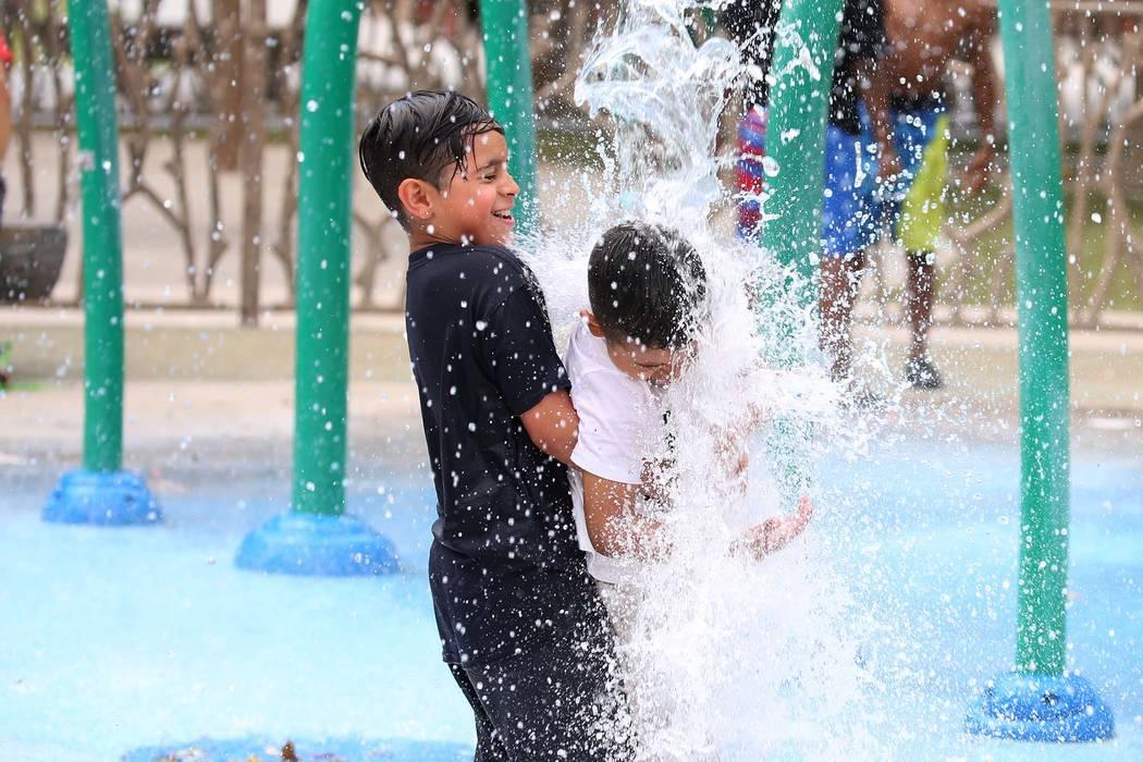 Two brothers play at Sunset Park in Las Vegas. (Bizuayehu Tesfaye/Las Vegas Review-Journal) @bizutesfaye