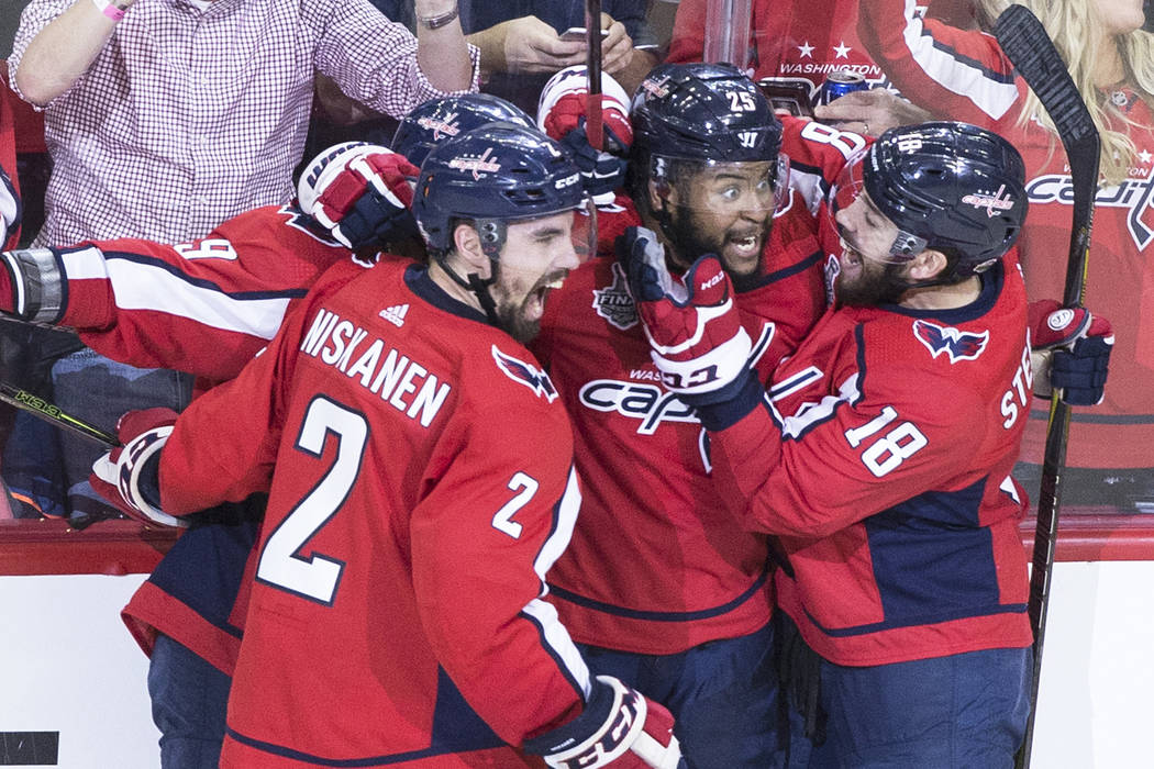 Capitals defenseman Matt Niskanen (2), right wing Devante Smith-Pelly (25) and center Chandler Stephenson (18) celebrate after Smith-Pelly scored a third-period goal during Game 3 of the NHL Stanl ...