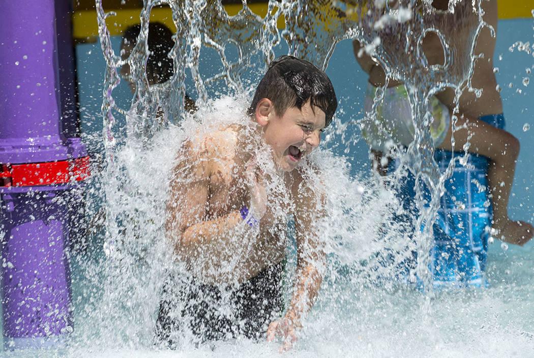 Las Vegas resident Gage Shepherd, 8, runs through a feature at the outdoor water park at Desert Breeze Aquatic Center in Las Vegas on Sunday, June 3, 2018. Richard Brian Las Vegas Review-Journal @ ...