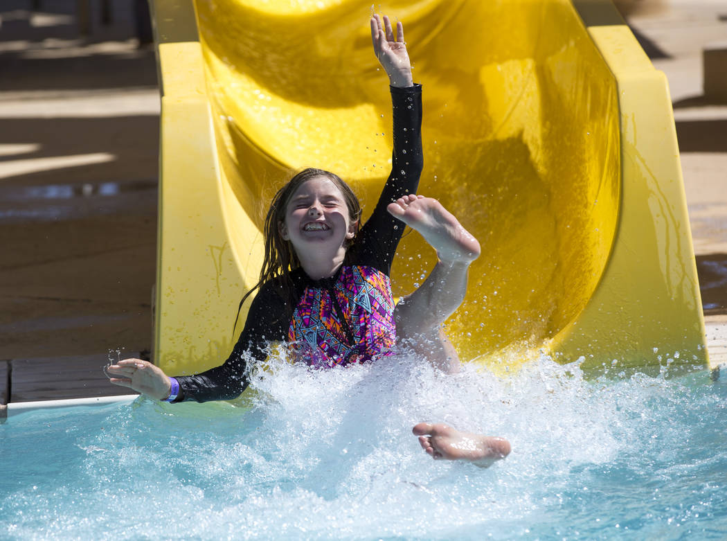 Summerlin resident Erika Harrison, 9, takes a turn on a water slide at the outdoor water park at Desert Breeze Aquatic Center in Las Vegas on Sunday, June 3, 2018. Richard Brian Las Vegas Review-J ...