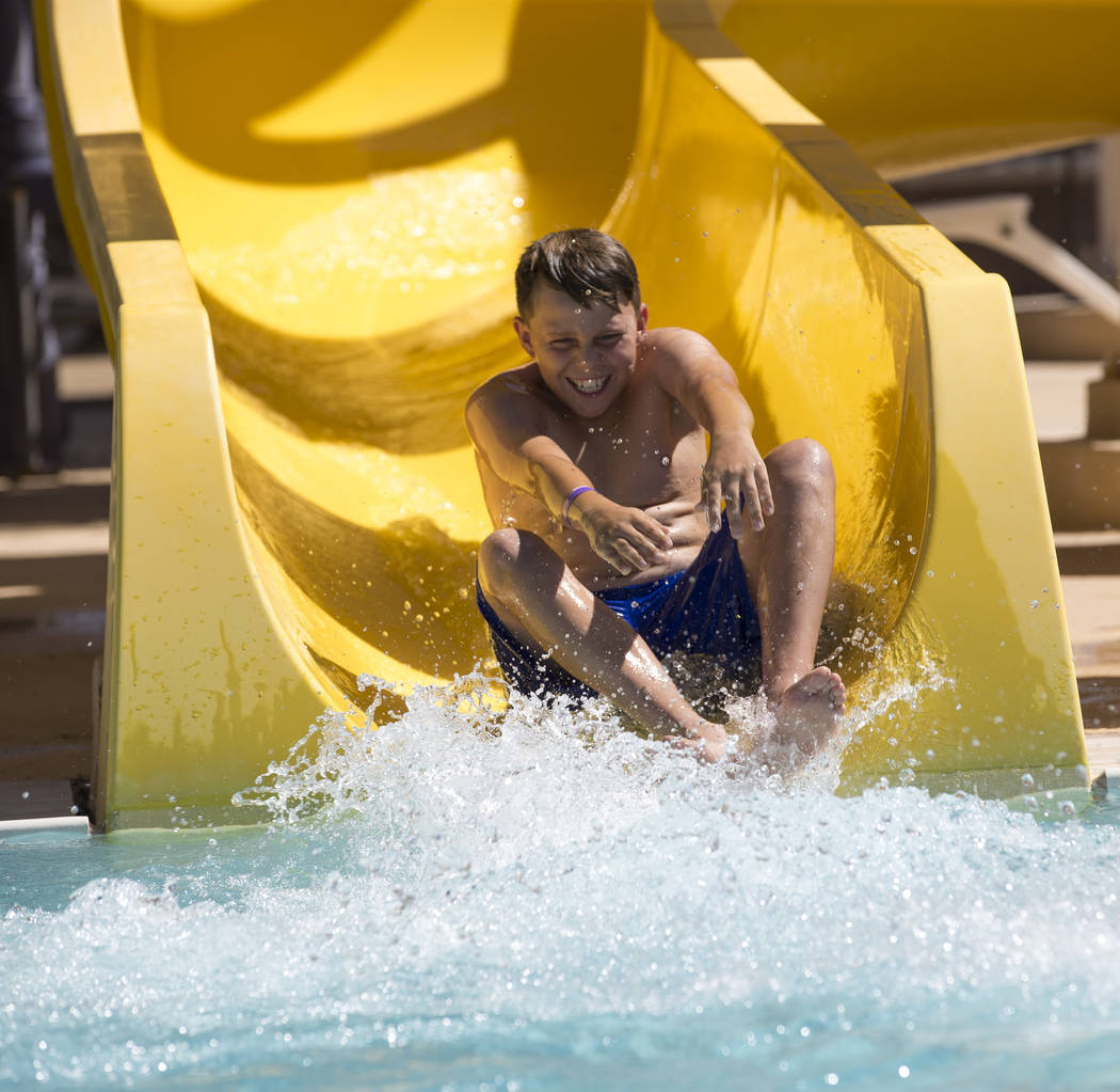Las Vegas resident Diego Yasinovsky, 11, takes a turn on a water slide at the outdoor water park at Desert Breeze Aquatic Center in Las Vegas on Sunday, June 3, 2018. Richard Brian Las Vegas Revie ...