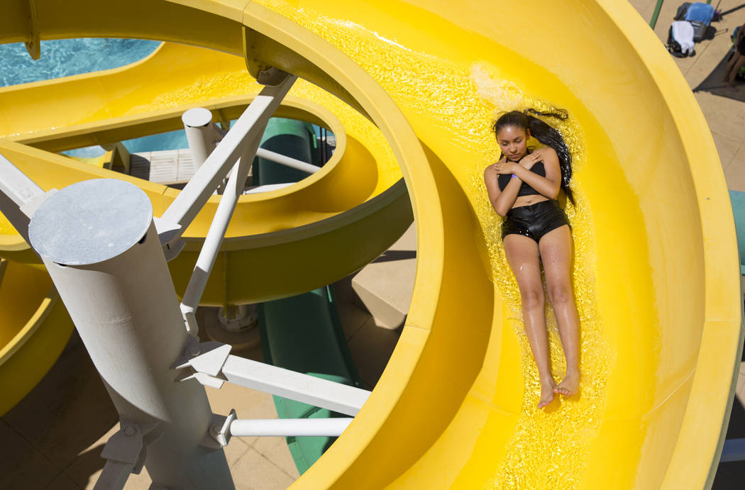 Las Vegas resident Sarai Fernandez takes a turn on a water slide at the outdoor water park at Desert Breeze Aquatic Center in Las Vegas on Sunday, June 3, 2018. Richard Brian Las Vegas Review-Jour ...