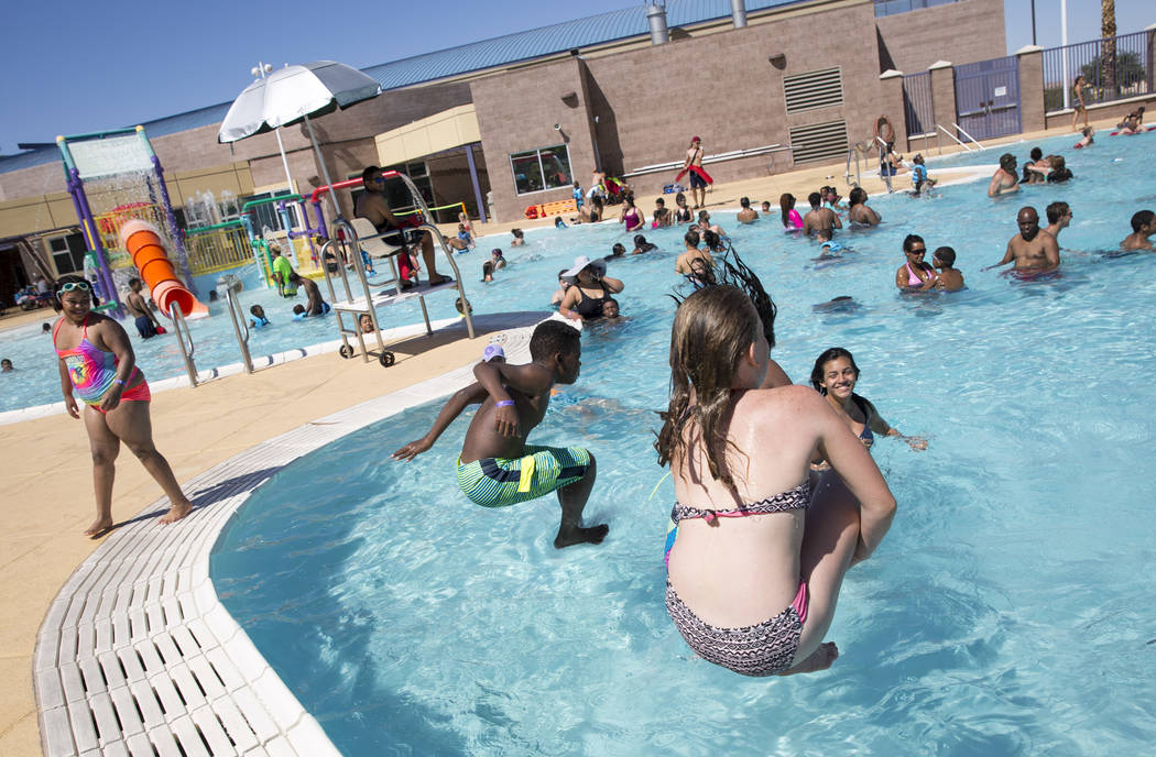 Youngsters cannonball into the pool at the outdoor water park at Desert Breeze Aquatic Center in Las Vegas on Sunday, June 3, 2018. Richard Brian Las Vegas Review-Journal @vegasphotograph