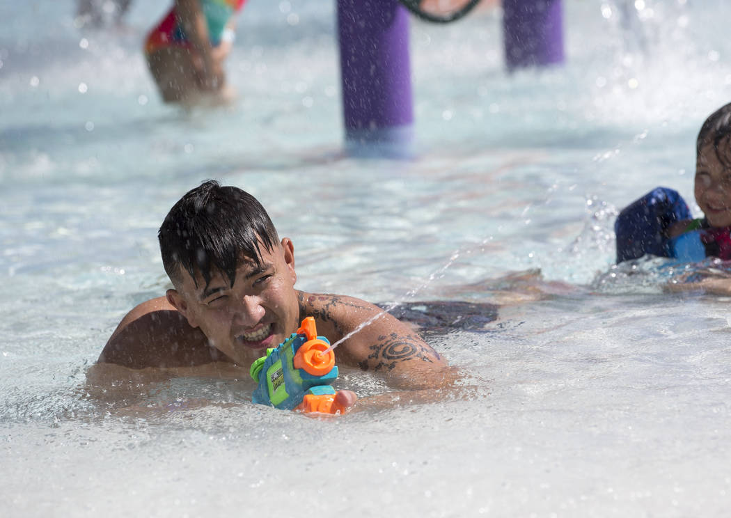 Isaiah Sacol shoots water gun while playing with family at the outdoor water park at Desert Breeze Aquatic Center in Las Vegas on Sunday, June 3, 2018. Richard Brian Las Vegas Review-Journal @vega ...