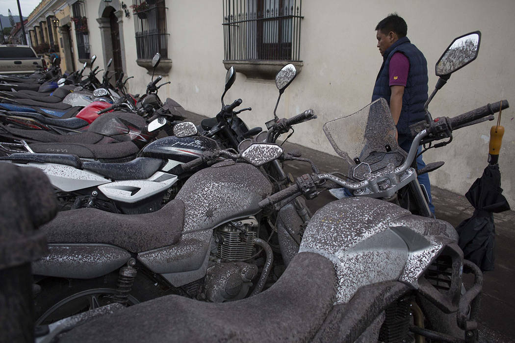 Volcanic ash covers parked motorcycles, brought by the Fuego Volcano, in Antigua Guatemala, Sunday, June 3, 2018. Volcan del Fuego is one of the most active volcanoes in Central America. (AP Photo ...