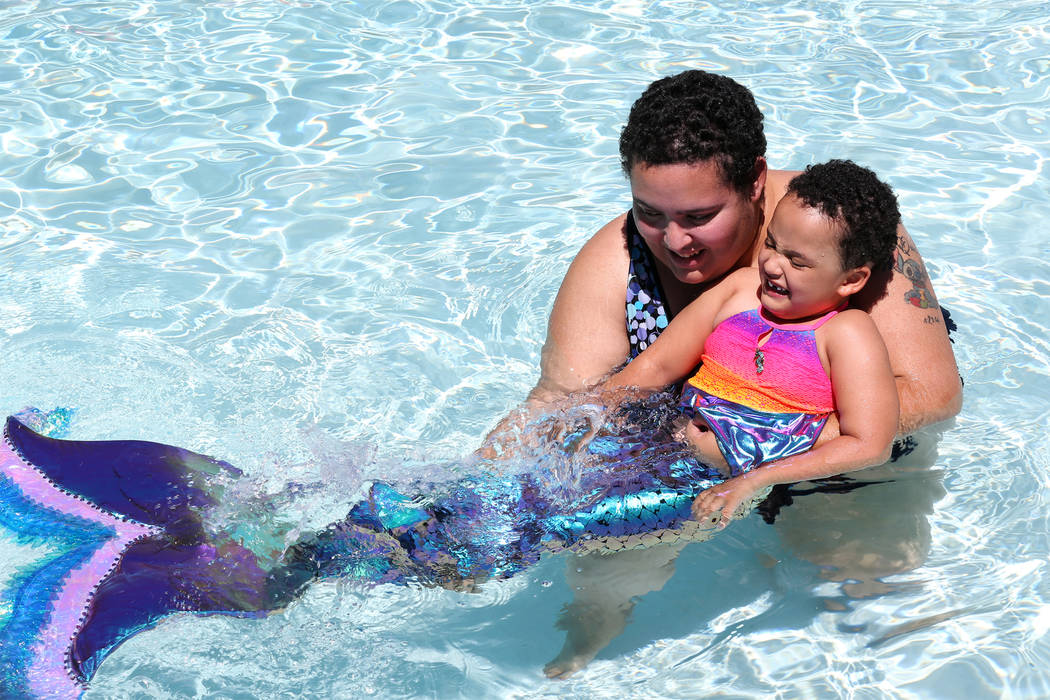 Ashley Downing with her four-year-old daughter Quinn at the Mandalay Bay Beach in Las Vegas, Tuesday, May 29, 2018. Downing, who was born with severe epilepsy, suffering multiple seizures daily, g ...