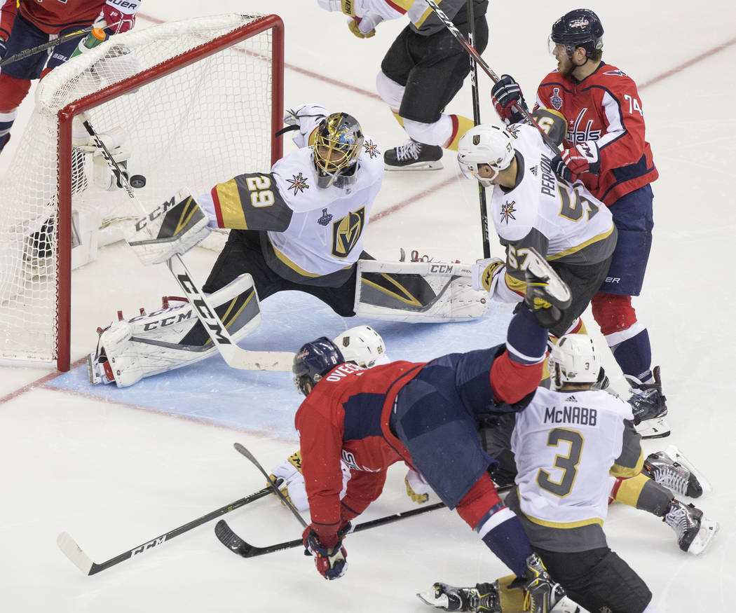 Capitals left wing Alex Ovechkin (8) scores a second-period goal against Golden Knights goaltender Marc-Andre Fleury (29) during Game 3 of the NHL Stanley Cup Final on Saturday, June 2, 2018, at C ...