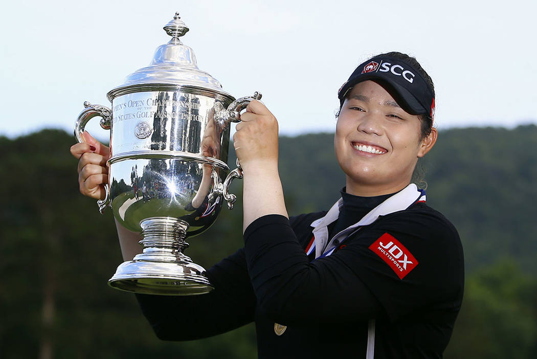 Ariya Jutanugarn, of Thailand, holds up the trophy after winning in a four hole playoff during the final round of the U.S. Women's Open golf tournament at Shoal Creek, Sunday, June 3, 2018, in Bir ...