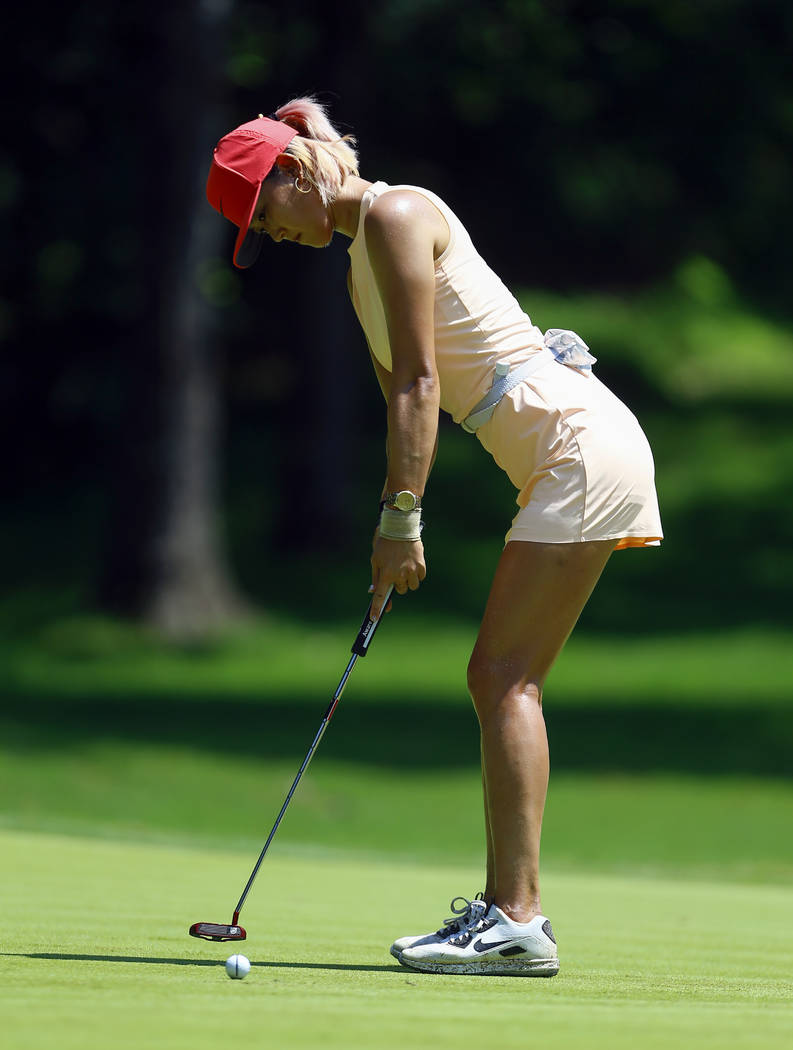 Michelle Wie putts for par on the first hole during the final round of the U.S. Women's Open golf tournament at Shoal Creek, Sunday, June 3, 2018, in Birmingham, Ala. (AP Photo/Butch Dill)