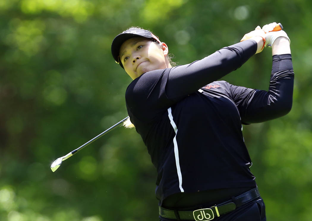Ariya Jutanugarn, of Thailand, tees off on the second hole during the final round of the U.S. Women's Open golf tournament at Shoal Creek, Sunday, June 3, 2018, in Birmingham, Ala. (AP Photo/Butch ...