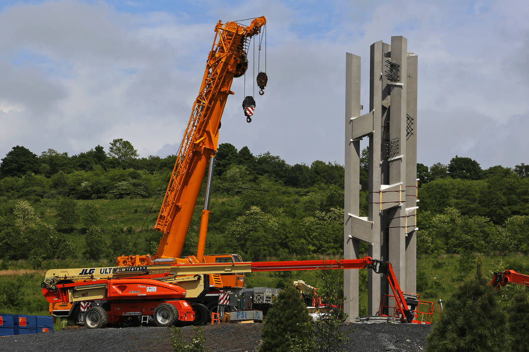 This May 31, 2018, photo shows the first section of the 93-foot tall Tower of Voices wind chimes is in place at the Flight 93 National Memorial in Shanksville, Pa. The final phase of the memorial ...