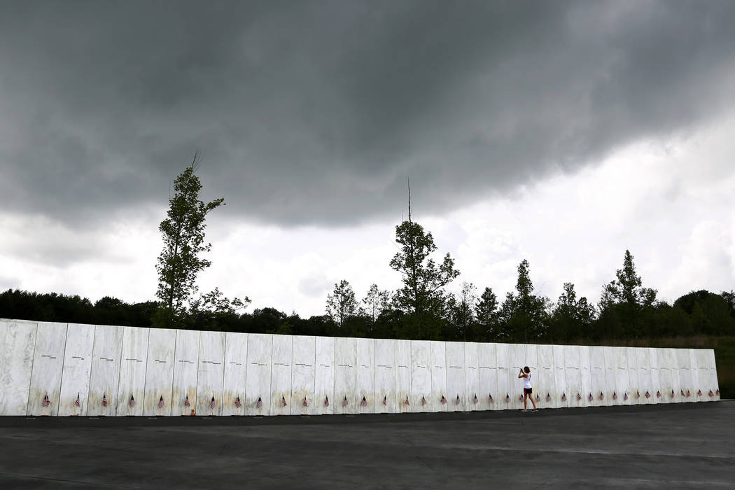 A visitor to the Flight 93 National Memorial pauses at the Wall of Names containing the names of the 40 passengers and crew of United Flight 93 that were killed in this field on Sept. 11, 2001, on ...