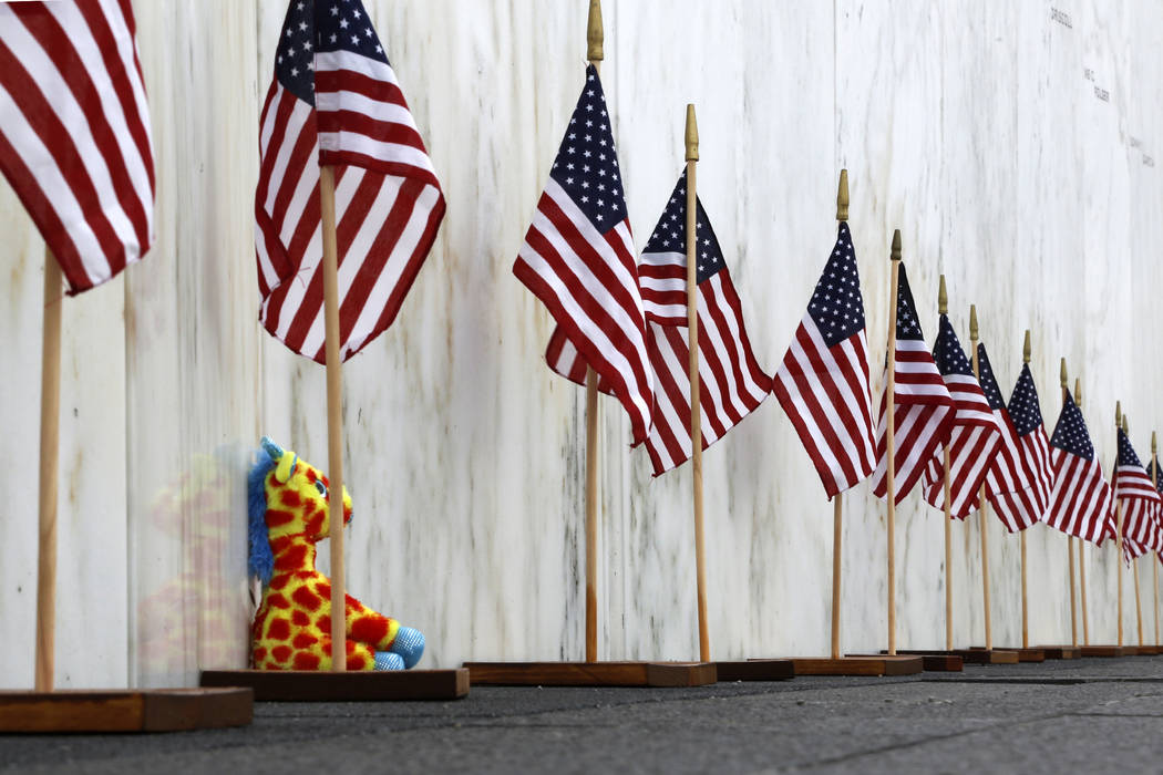 American Flags are placed at the Wall of Names at the Flight 93 National Memorial on Thursday, May 31, 2018. Later this year, the remaining wreckage of Flight 93 will be returned to the Flight 93 ...