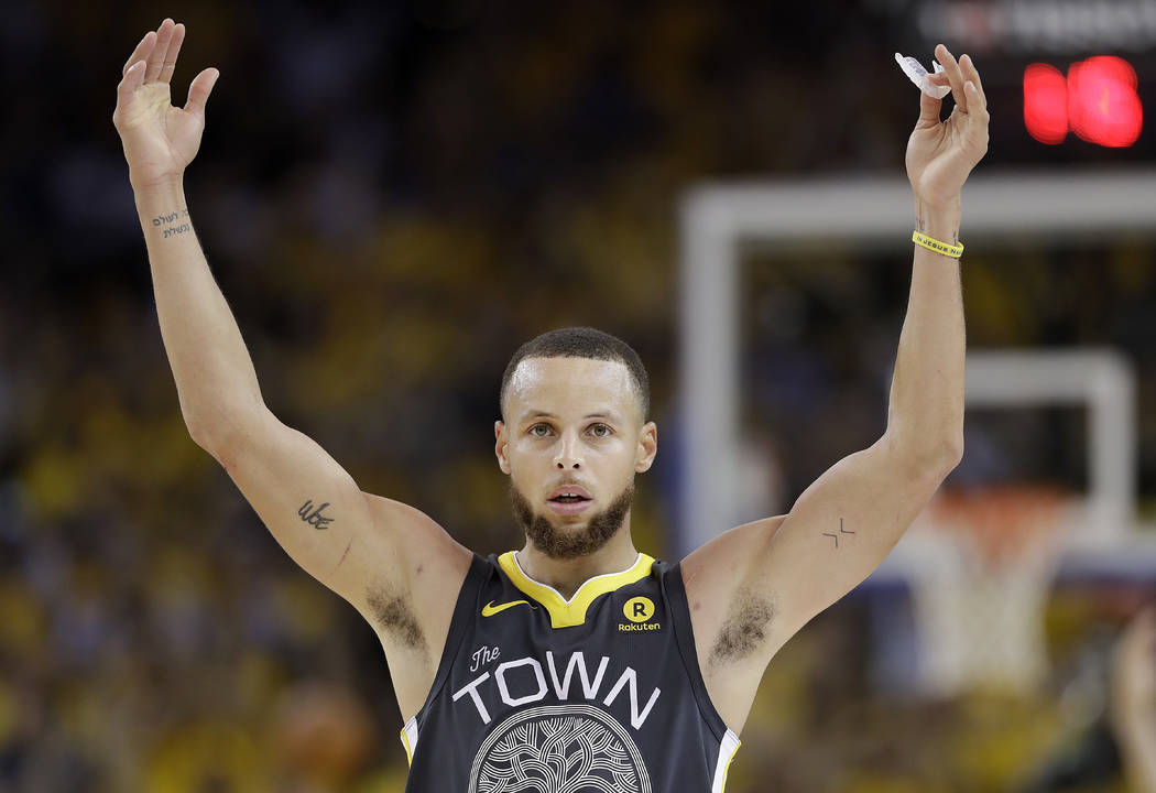 Golden State Warriors guard Stephen Curry (30) celebrates during the second half of Game 2 of basketball's NBA Finals between the Warriors and the Cleveland Cavaliers in Oakland, Calif., Sunday, J ...