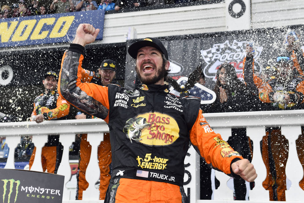 Martin Truex Jr. celebrates in Victory Lane after winning a NASCAR Cup Series auto race Sunday, June 3, 2018, in Long Pond, Pa. (AP Photo/Derik Hamilton)