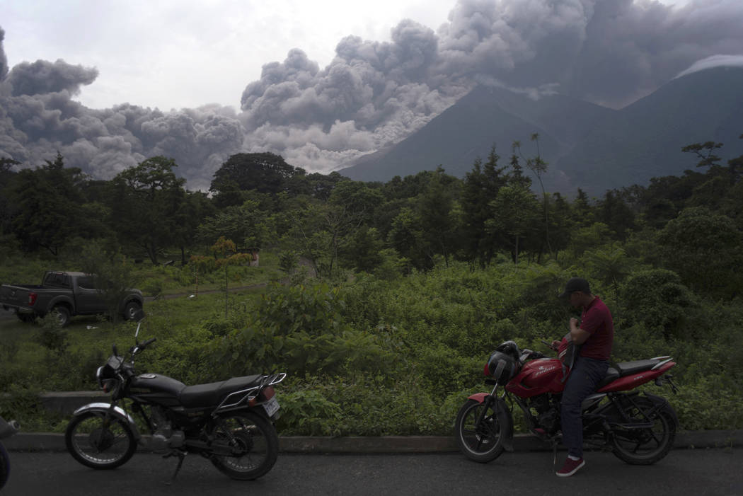 Volcan de Fuego, or Volcano of Fire, blows outs a thick cloud of ash, as seen from Alotenango, Guatemala, Sunday, June 3, 2018. One of Central America's most active volcanos erupted in fiery explo ...