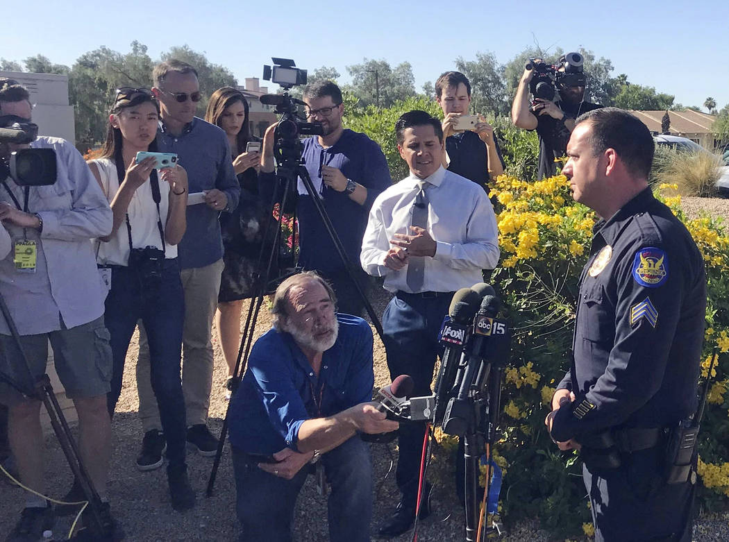 Phoenix police spokesman Sgt. Vince Lewis, right, speaks to reporters outside a hotel in Scottsdale, Ariz., Monday, June 4, 2018, where police say a man suspected in several homicides killed himse ...