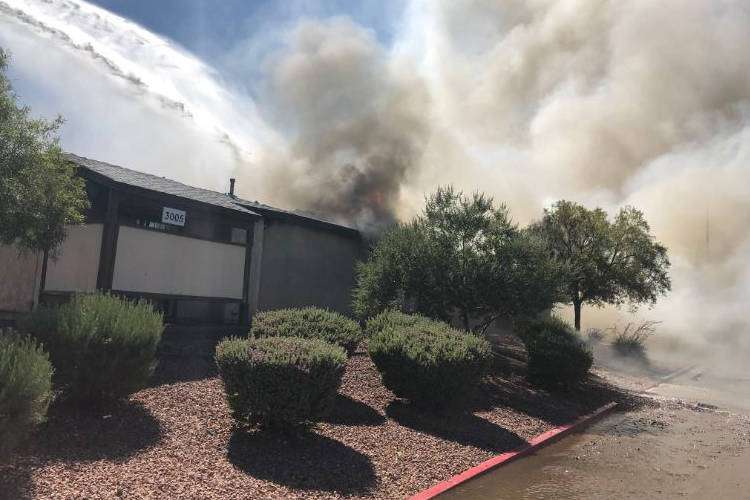 Sunday's fire at 3005 Saint George St., near Cheyenne Avenue and Civic Center Drive, displaced seven people living in the fourplex. (North Las Vegas Fire Department)