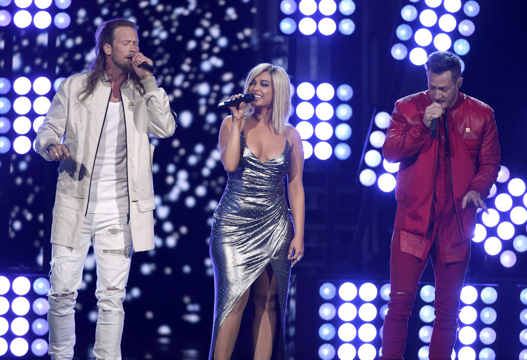 "Tyler Hubbard, right, and Brian Kelley of Florida Georgia Line and Bebe Rexha perform ""Meant to Be"" at the 53rd annual Academy of Country Music Awards at the MGM Grand Garden Arena on Sunday, Apri ..."