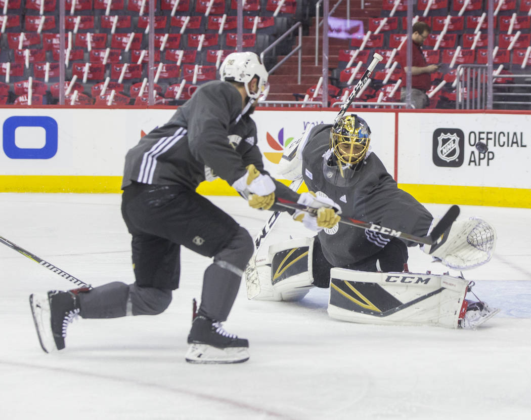 Golden Knights goaltender Marc-Andre Fleury (29) makes a save during practice leading up to Game 4 of the NHL Stanley Cup Final with the Washington Capitals on Monday, June 4, 2018, in Washington ...