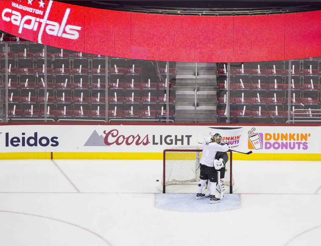 Golden Knights goaltender Marc-Andre Fleury (29) gets a hug from right wing Pierre-Edouard Bellemare (41) during practice leading up to Game 4 of the NHL Stanley Cup Final with the Washington Capi ...