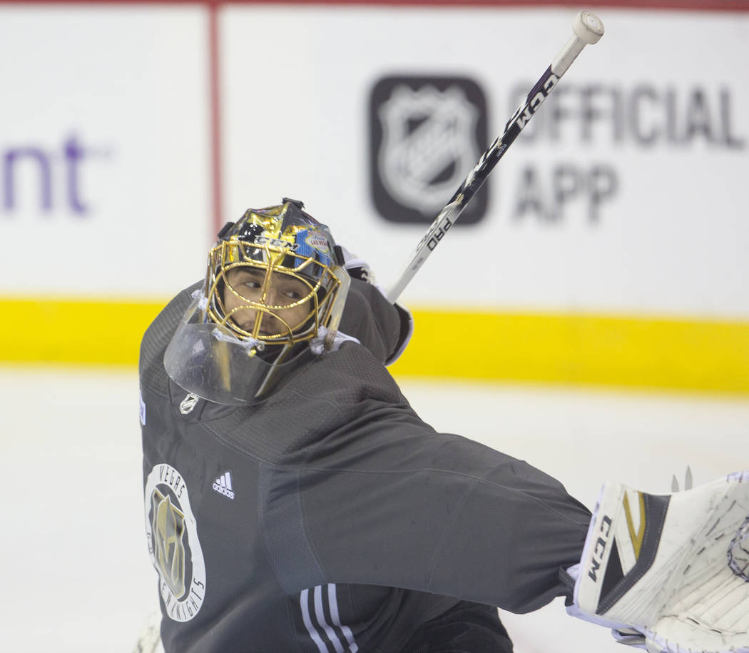 Golden Knights goaltender Marc-Andre Fleury (29) makes a save during practice leading up to Game 4 of the NHL Stanley Cup Final with the Washington Capitals on Monday, June 4, 2018, in Washington. ...