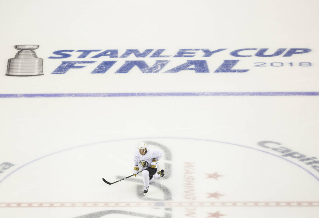 Golden Knights center Cody Eakin (21) stretches before the start of practice leading up to Game 4 of the NHL Stanley Cup Final with the Washington Capitals on Monday, June 4, 2018, in Washington. ...