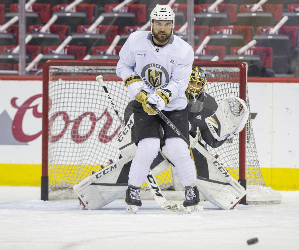 Golden Knights goaltender Marc-Andre Fleury (29) and left wing William Carrier (28) work through a drill during practice leading up to Game 4 of the NHL Stanley Cup Final with the Washington Capi ...