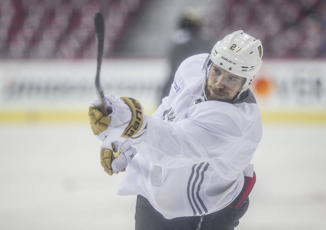 Golden Knights defenseman Shea Theodore (27) takes a shot during practice leading up to Game 4 of the NHL Stanley Cup Final with the Washington Capitals on Monday, June 4, 2018, in Washington. Ben ...