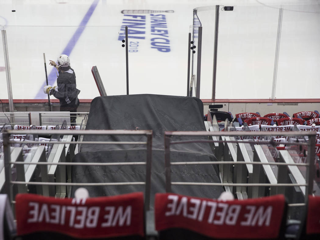 Golden Knights defenseman Colin Miller (6) tosses a puck on the ice before the start of practice leading up to Game 4 of the NHL Stanley Cup Final with the Washington Capitals on Monday, June 4, 2 ...