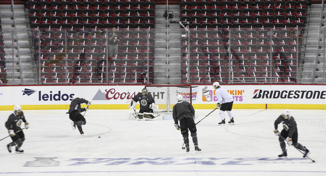 Golden Knights players take shots on Golden Knights goaltender Marc-Andre Fleury during practice ahead of Game 4 of the Stanley Cup Final at Capital One Arena in Washington on Monday, June 4, 2018 ...