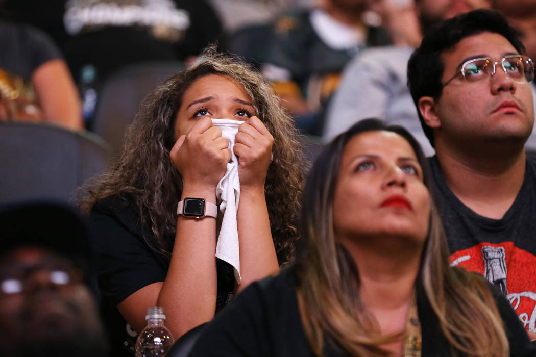 Fans react during a watch party for Game 4 of the Stanley Cup Final between the Golden Knights and the Washington Capitals at T-Mobile Arena, June 4, 2018 in Las Vegas. Richard Brian Las Vegas Rev ...