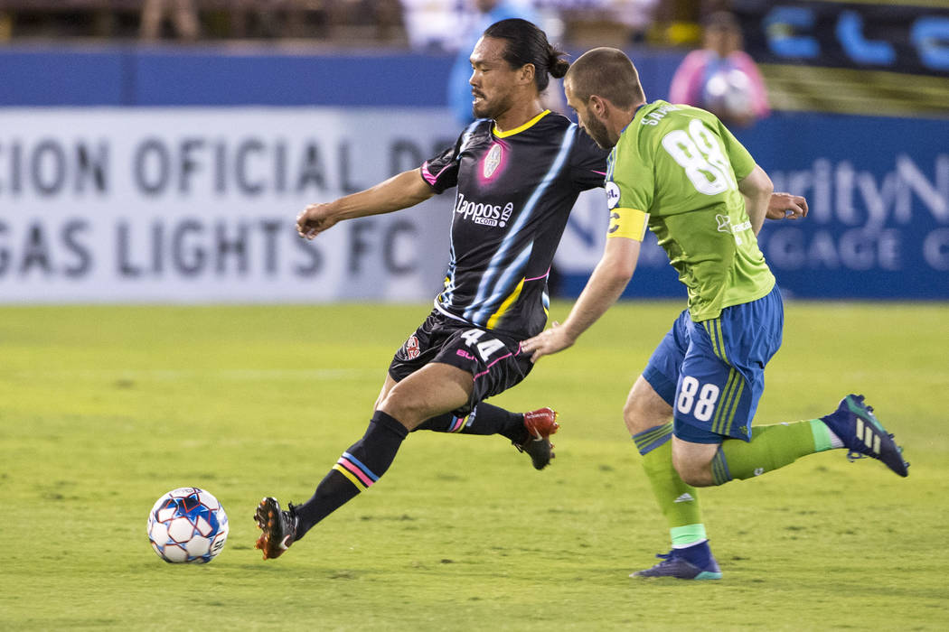 Las Vegas Lights FC Daigo Kobayashi (44) passes the ball past Seattle Sounders FC 2 midfielder Ray Saari (88) during the first half of a United Soccer League match at Cashman Field in downtown Las ...