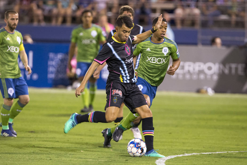 Las Vegas Lights FC midfielder Carlos Alvarez (7) takes a shot against the Seattle Sounders FC 2 during the first half of a United Soccer League match at Cashman Field in downtown Las Vegas on Sat ...