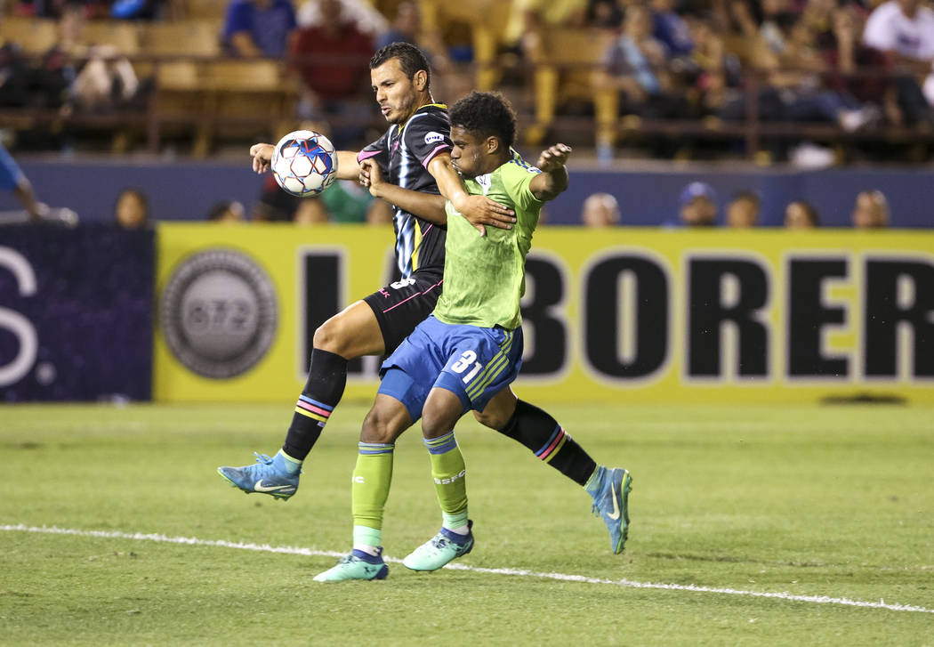 Las Vegas Lights FC forward Sammy Ochoa (9) and Seattle Sounders FC 2 defender Nick Hinds (31) vie for the ball during the second half of a United Soccer League match at Cashman Field in downtown ...