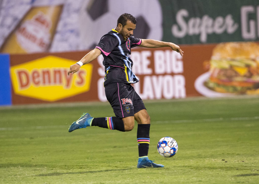 Las Vegas Lights FC forward Sammy Ochoa (9) shoots for a goal against the Seattle Sounders FC 2 during the first half of a United Soccer League match at Cashman Field in downtown Las Vegas on Satu ...