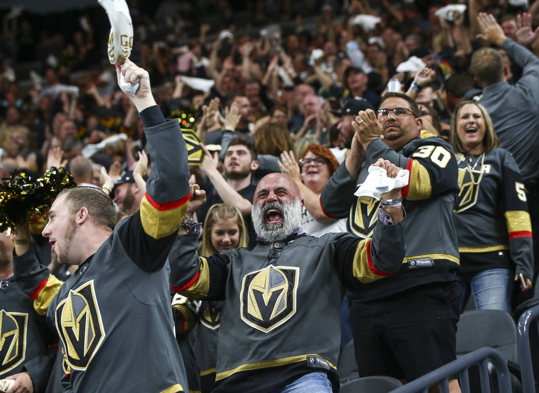 Golden Knights fans celebrate a goal by Golden Knights defenseman Shea Theodore, not pcitured, during the second period of Game 2 of the NHL hockey Stanley Cup Final at the T-Mobile Arena in Las V ...