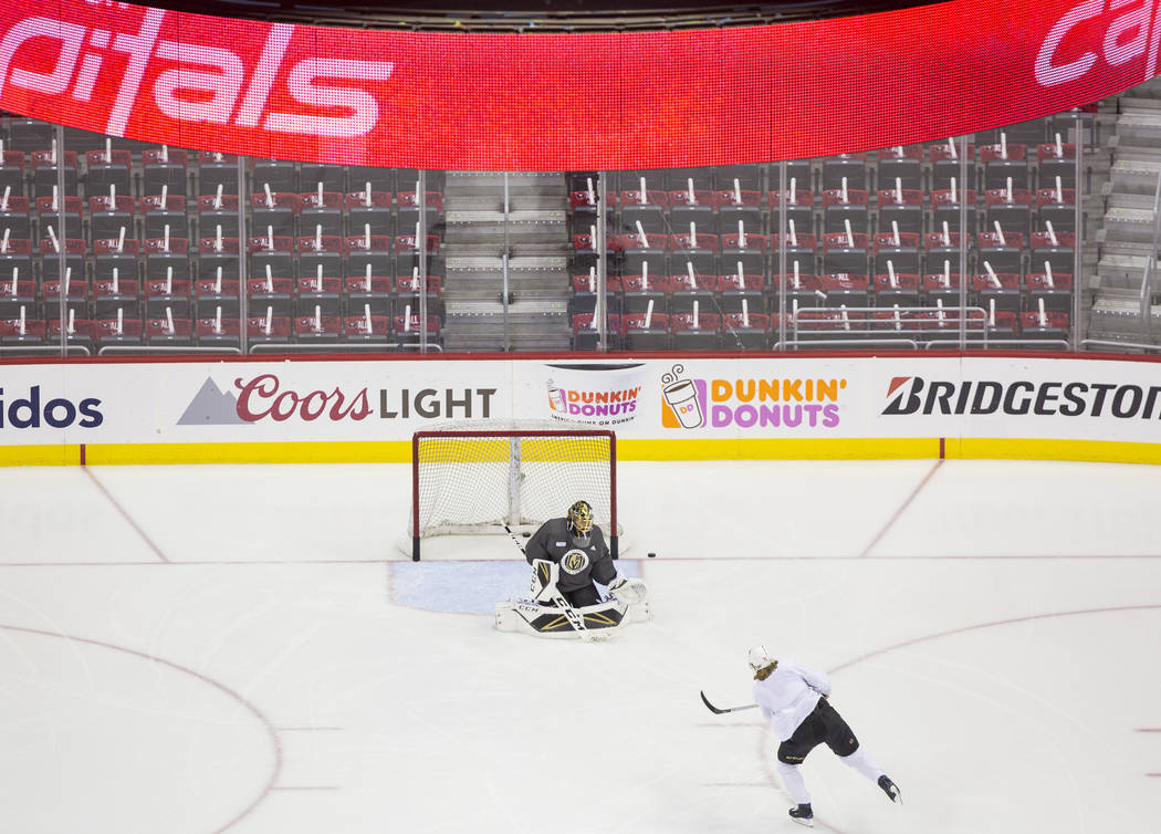 Golden Knights goaltender Marc-Andre Fleury (29) makes a save on center William Karlsson (71) during practice leading up to Game 4 of the NHL Stanley Cup Final with the Washington Capitals on Mond ...