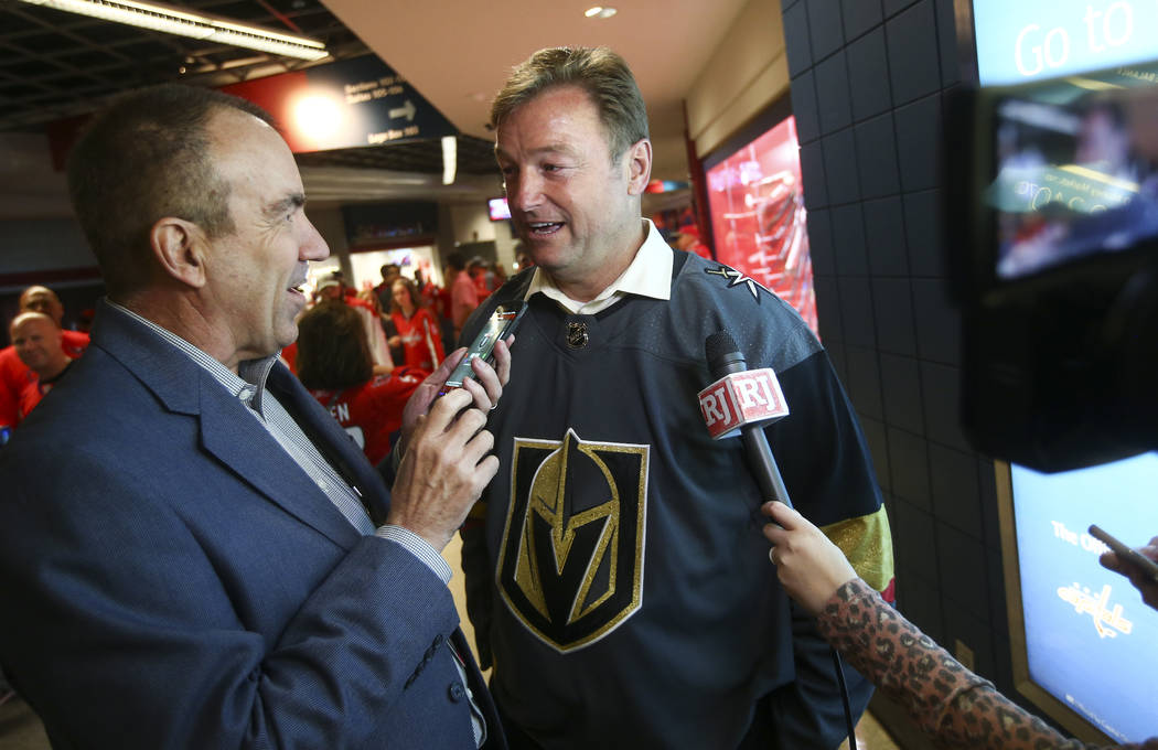 Review-Journal columnist Ron Kantowski talks with U.S. Sen. Dean Heller, R-Nev., before the start of Game 4 of the Stanley Cup Final at Capital One Arena in Washington on Monday, June 4, 2018. Cha ...