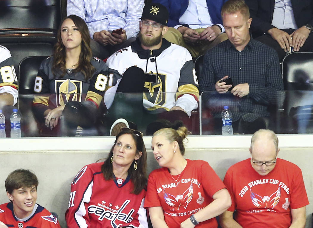 Washington Nationals player Bryce Harper, center, looks on at the start of Game 4 of the Stanley Cup Final at Capital One Arena in Washington on Monday, June 4, 2018. Chase Stevens Las Vegas Revie ...