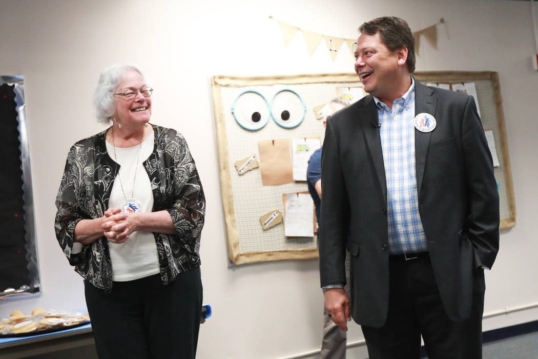 Clark County School District trustee Carolyn Edwards smiles as superintendent Pat Skorkowsky, who is retiring, reacts after a surprise party at C.C. Ronnow Elementary School in Las Vegas on Friday ...