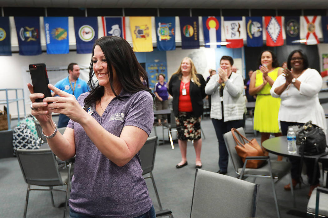 Teachers and staff react as superintendent Pat Skorkowsky, who is retiring, walks in to a surprise party at C.C. Ronnow Elementary School in Las Vegas on Friday, May 4, 2018. Andrea Cornejo Las Ve ...