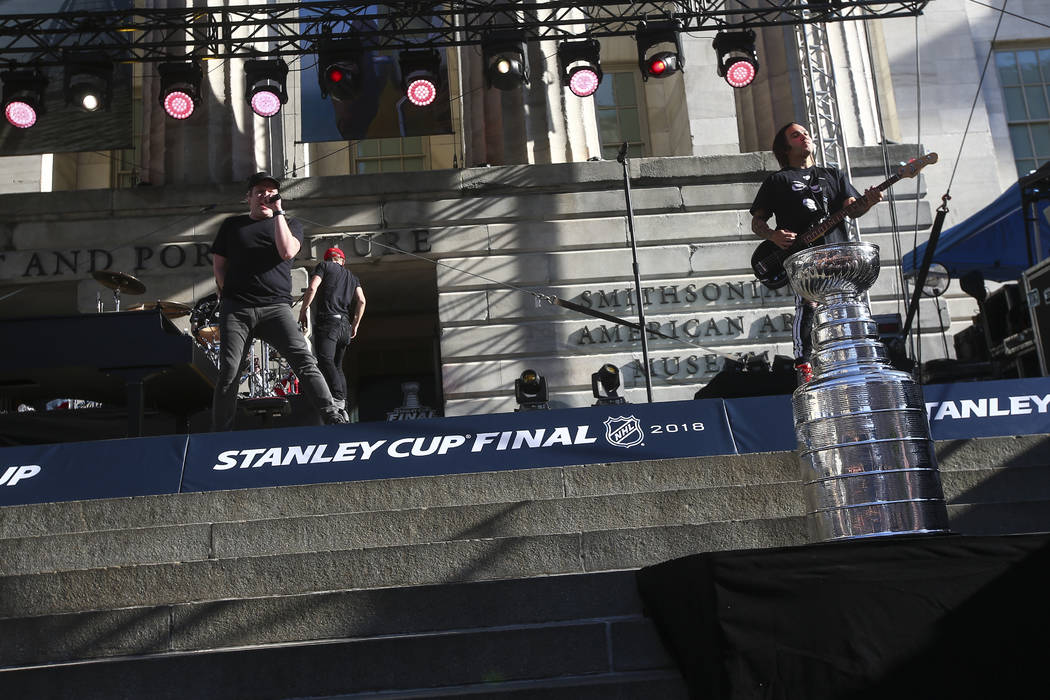 Fall Out Boy performs outside of the National Portrait Gallery before Game 4 of the Stanley Cup Final at Capital One Arena in Washington on Monday, June 4, 2018. Chase Stevens Las Vegas Review-Jou ...