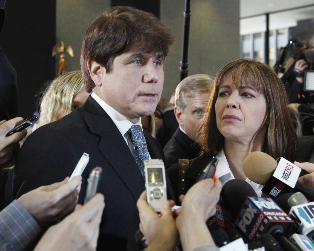 FILE - In this Dec. 7, 2011 file photo, former Illinois Gov. Rod Blagojevich, left, speaks to reporters as his wife, Patti, listens at the federal building in Chicago. President Donald Trump says ...