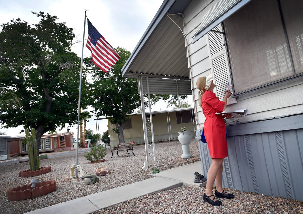 Clark County Commissioner and Nevada Governor candidate Chris Giunchigliani speaks with a resident through a window as she canvases potential voters at the Riviera Mobile Home Park Tuesday, June 5 ...