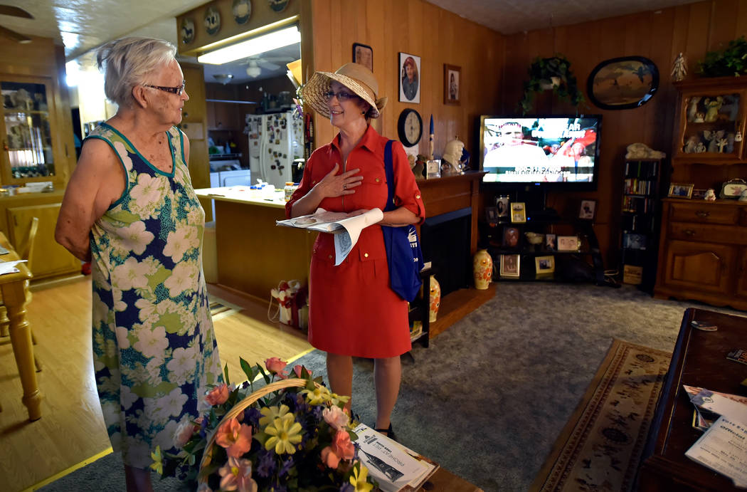 Clark County Commissioner and Nevada Governor candidate Chris Giunchigliani, right, speaks with a Charlene McNeill inside her home as she canvases potential voters at the Riviera Mobile Home Park ...