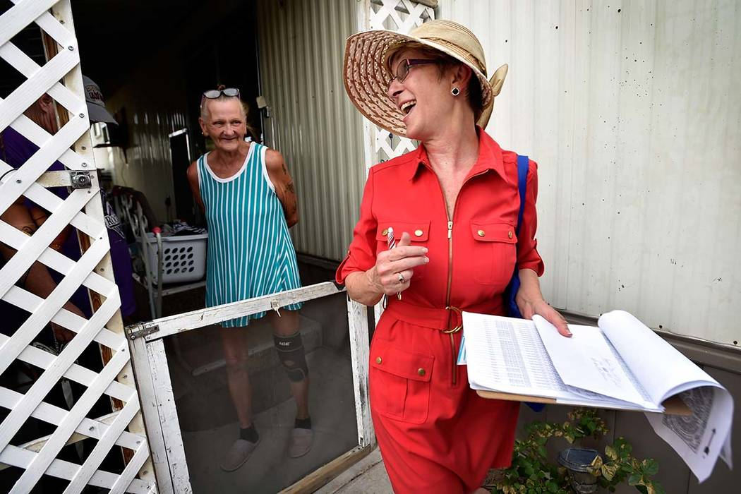 Clark County Commissioner and Nevada Governor candidate Chris Giunchigliani, right, smiles after speaking with residents as she canvases potential voters at the Riviera Mobile Home Park Tuesday, J ...