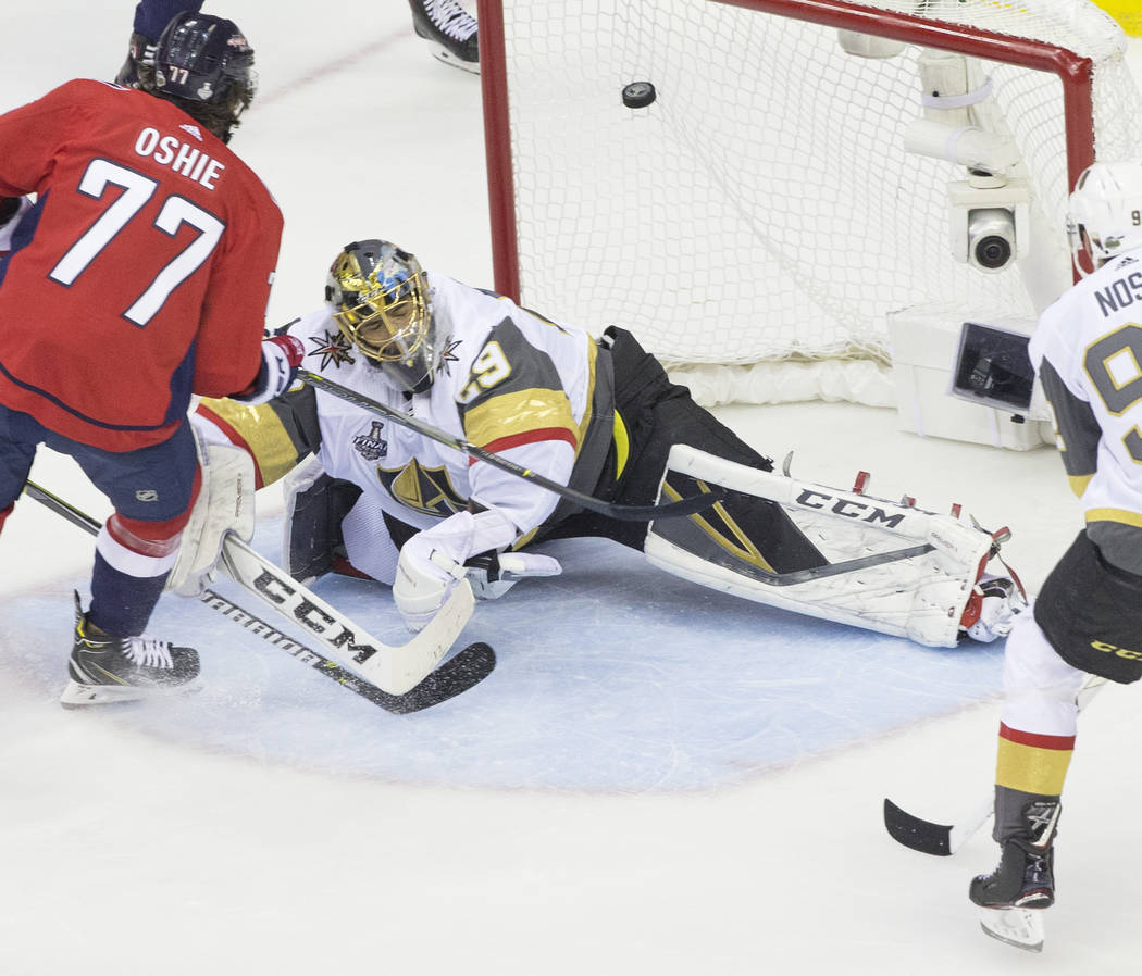 Capitals right wing T.J. Oshie (77) scores a first-period goal against Golden Knights goaltender Marc-Andre Fleury (29) during Game 4 of the NHL Stanley Cup Final on Monday, June 4, 2018, at Capi ...