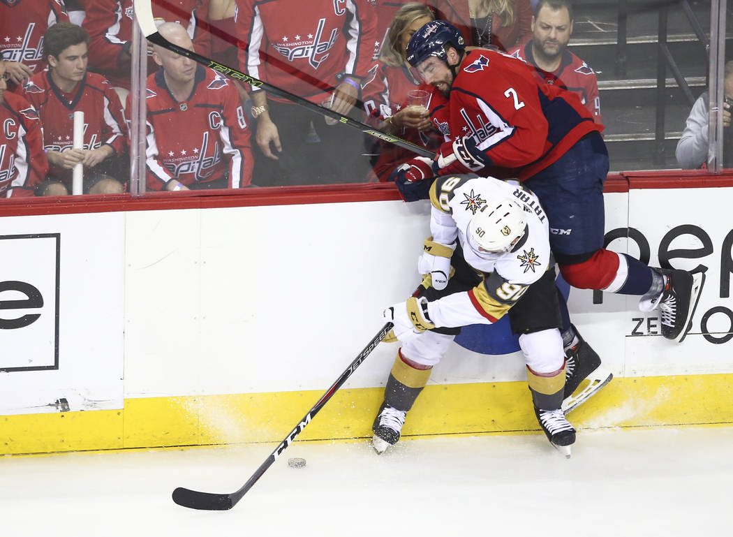 Golden Knights left wing Tomas Tatar (90) checks Washington Capitals defenseman Matt Niskanen (2) during the first period of Game 4 of the Stanley Cup Final at Capital One Arena in Washington on M ...